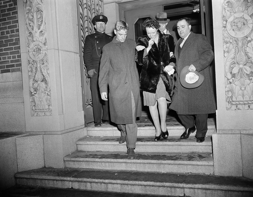 . An unidentified woman leaves Boston city morgue, Nov. 29, 1942 with a pair of escorts after attempting to identify some of the bodies brought from the fire-wrecked Cocoanut Grove Night Club. (AP Photo)