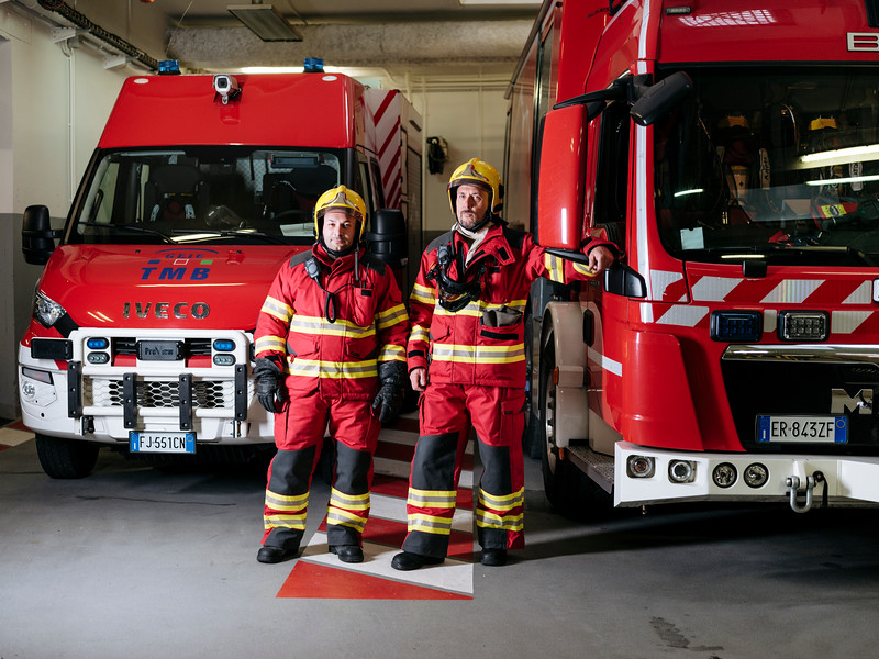 Alex Paonna (left) and Rudy Fassin (right), direct response crew (professional firefighters) next to a Proteus truck, in the firefighter hangar on the French side - Samuel Zeller for the New York Times