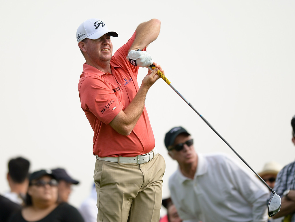 . Robert Garrigus uses English on the club as he tees off from the third hole during the third round of the Northern Trust Open, Saturday, February 15, 2014, at Riviera Country Club. (Photo by Michael Owen Baker/L.A. Daily News)