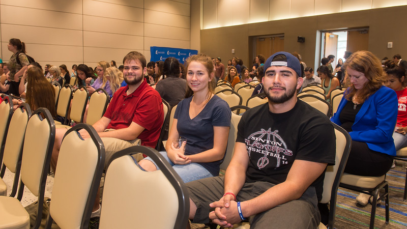 Dustin Wehe (left), Christine Shaw, and Isaac Martinez smile for our cameras while attending the When We Are Bold speaker event.