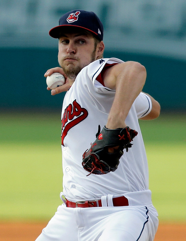 . Cleveland Indians starting pitcher Trevor Bauer winds up during the first inning of the team\'s baseball game against the Toronto Blue Jays, Friday, July 21, 2017, in Cleveland. (AP Photo/Tony Dejak)