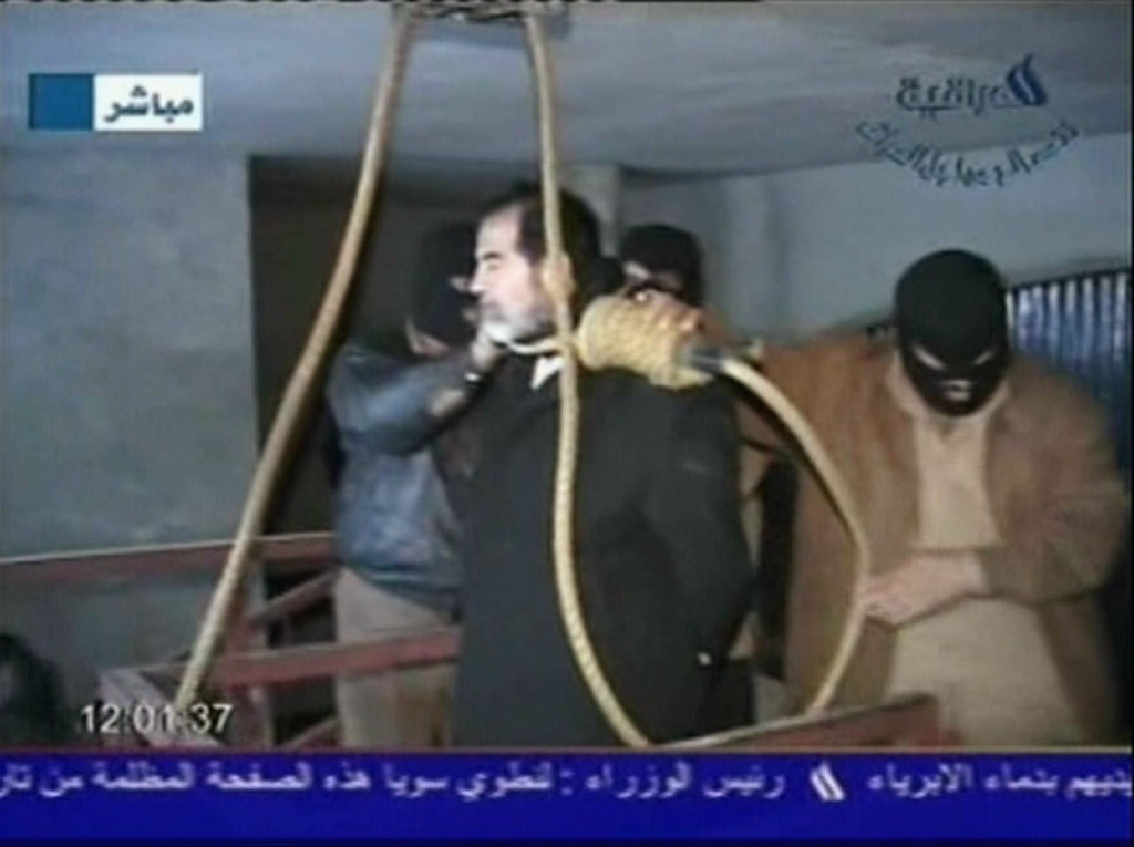 . In this television screen grab taken from Iraqi national television station Al-iraqia, a video shows the moments leading up to the execution of former Iraqi dictator Saddam Hussein as he was prepared for hanging and the noose is put over his head on the gallows, on December 30, 2006 in Baghdad, Iraq. The former Iraqi president was executed by hanging at 0600 (0300 GMT) in a secure facility in the Northern Baghdad suburb of Khadimeya. (Photo by Al-iraqia via Getty Images)