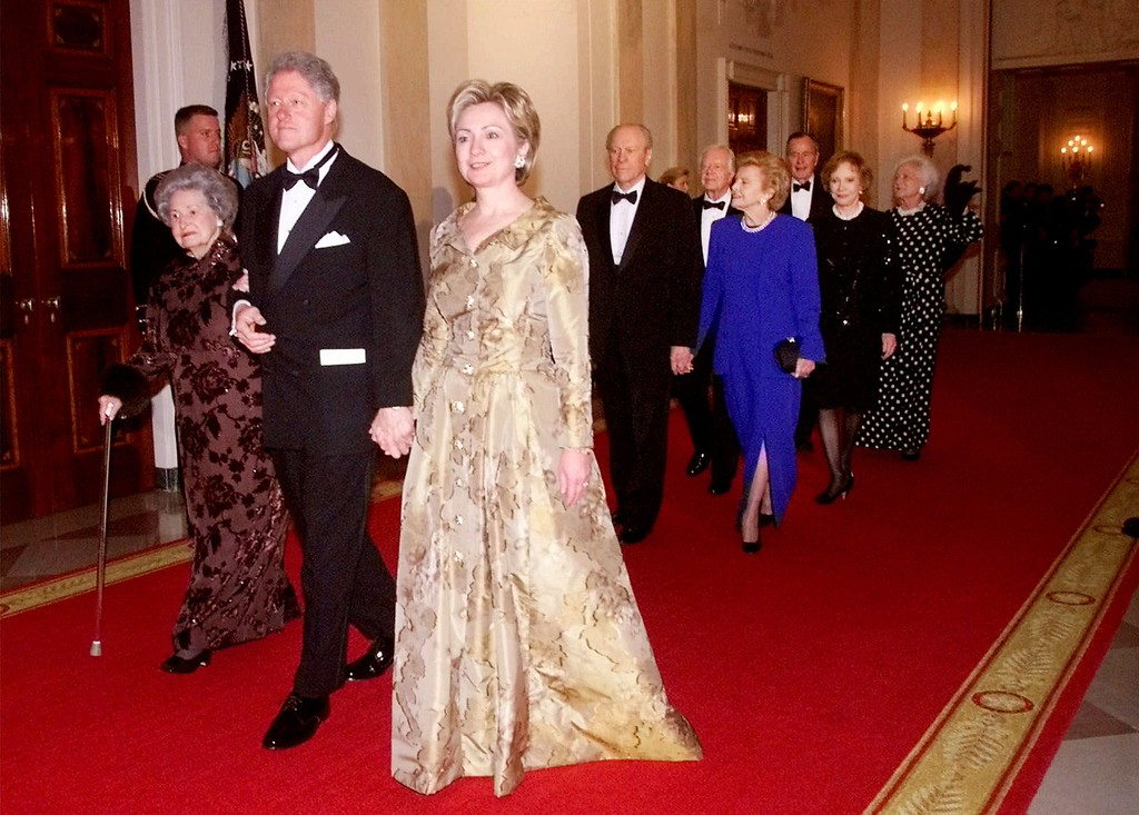 . President Clinton, left, escorts first Lady Hillary Rodham Clinton and former first lady Lady Bird Johnson as they are followed by former President Gerald R. Ford with former first lady Betty Ford, former President Jimmy Carter with former first lady Rosalynn Carter, and former President George Bush with former first lady Barbara Bush, as they make their entrance into the East Room during a dinner in honor of the 200th Anniversary of the White House Thursday, Nov. 9, 2000 in Washington. (AP Photo/PabloMartinez Monsivais)