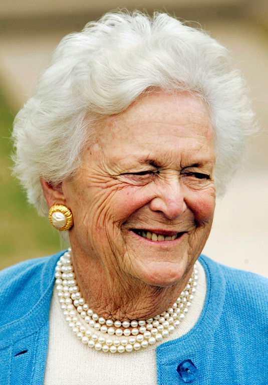 . Former First lady Barbara Bush chats with a person in attendance at the dedication ceremony of the George W. Bush childhood home in Midland, Texas, Tuesday, April 11, 2006. (AP Photo/Tony Gutierrez)