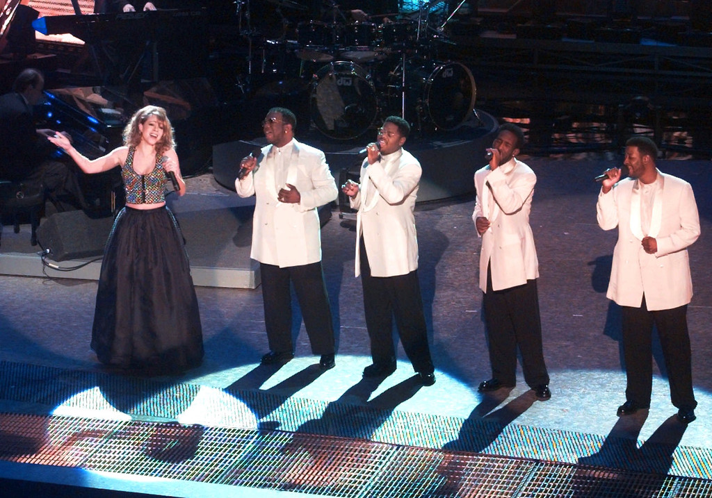 . Mariah Carey performs with Boyz II Men during the opening of the 38th annual Grammy Awards at the Shrine Auditorium in Los Angeles Wednesday, Feb. 28, 1996. Boyz II Men members are, from right, Nate Morris, Shawn Stockman, Michael McCary and Wanya Morris. (AP Photo/Eric Draper)