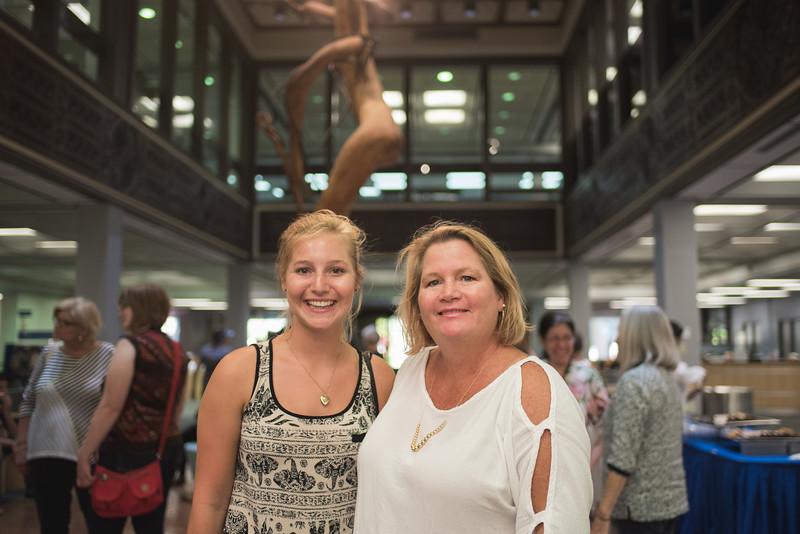 Jensen and Heather DeGrande at the Islander Cell Phone Photography Show in the Mary and Jeff Bell Library.