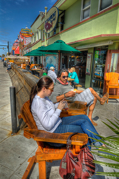 A couple enjoy the captain's chairs outside Oceanfront Bar & Grill on the Boardwalk in Myrtle Beach, SC on Saturday, March 10, 2012. Copyright 2012 Jason Barnette
