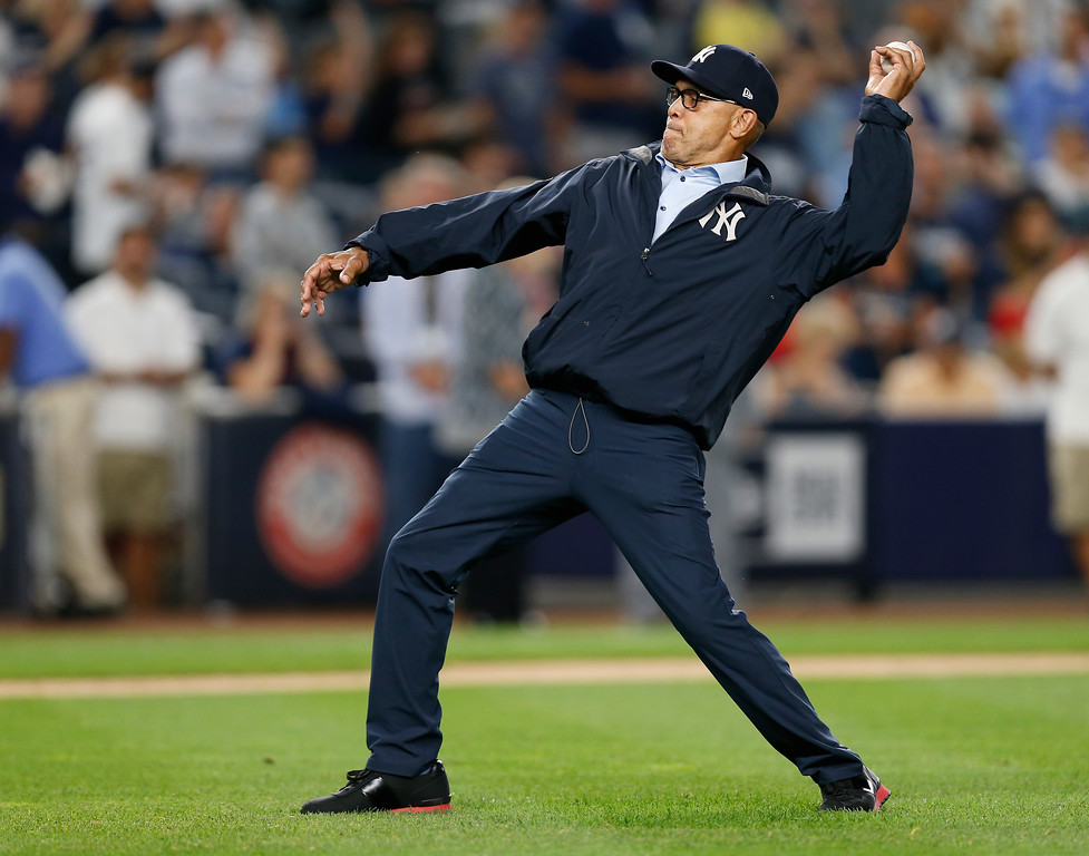 . Former New York Yankees player Reggie Jackson throws out the ceremonial first pitch before baseball\'s Game 3 of the American League Division Series, Sunday, Oct. 8, 2017, in New York. (AP Photo/Kathy Willens)