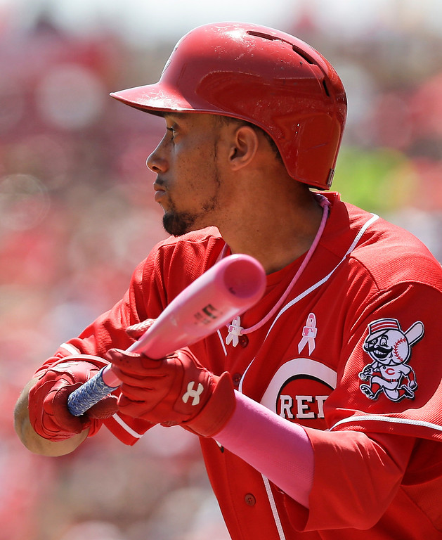 . Cincinnati Reds\' Billy Hamilton squares to bun against Colorado Rockies starting pitcher Juan Nicasio in the first inning of a baseball game, Sunday, May 11, 2014, in Cincinnati. Hamilton was using a pink bat for Mother\'s Day. Hamilton bunted for a single in the at bat. (AP Photo/Al Behrman)