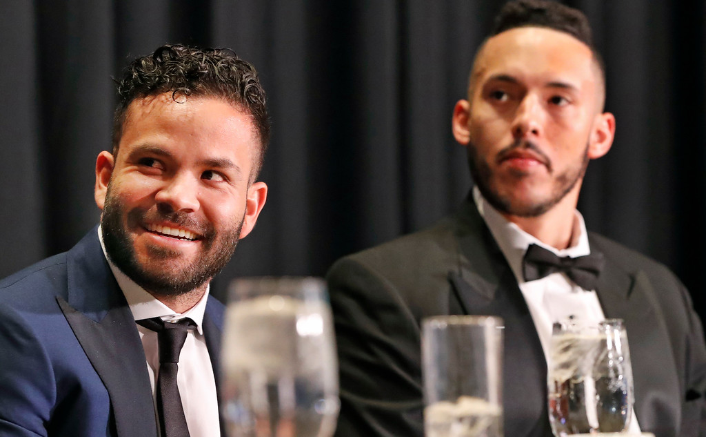 . American League Most Valuable Player Jose Altuve, left, of the Houston Astros and teammate Carlos Correa listen during the New York Chapter of the Baseball Writers\' Association of America annual dinner in New York, Sunday, Jan. 28, 2018. (AP Photo/Kathy Willens)