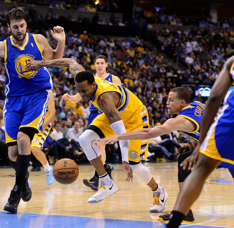 . DENVER, CO. - APRIL 20: Denver Nuggets shooting guard Andre Iguodala (9) is stripped while driving in the lane in the third quarter. The Denver Nuggets took on the Golden State Warriors in Game 1 of the Western Conference First Round Series at the Pepsi Center in Denver, Colo. on April 20, 2013. (Photo by AAron Ontiveroz/The Denver Post)