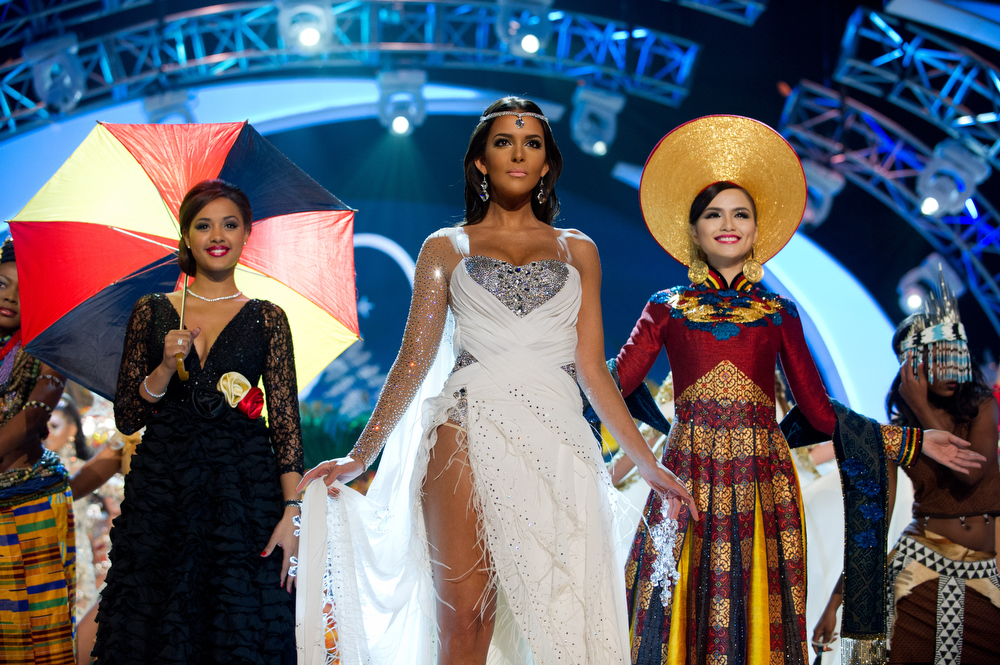 . Miss Belgium 2012, Laura Beyne; Miss Finland 2012, Sara Chafak; and Miss Korea 2012, Sung-hye Lee, perform onstage at the 2012 Miss Universe National Costume Show on Friday, Dec. 14, 2012 at PH Live in Las Vegas, Nevada. The 89 Miss Universe Contestants will compete for the Diamond Nexus Crown on Dec. 19, 2012. (AP Photo/Miss Universe Organization L.P., LLLP)