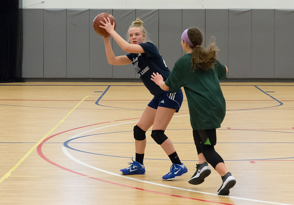 02/011/19 Wesley Bunnell | Staff Members of the girls 7th and 8th grade St. Joseph's basketball team practiced at the Bristol Boys and Girls Club on Monday afternoon. Camryn Lefrancois with the ball as she looks to pass.