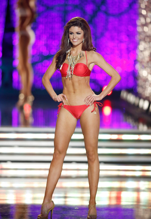 . Miss Wyoming Lexie Madden competes in the swimsuit portion of the Miss America 2013 pageant on Saturday, Jan. 12, 2013, in Las Vegas. (AP Photo/Isaac Brekken)