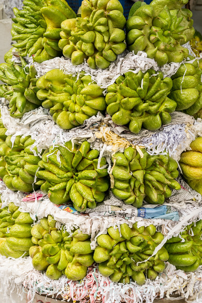 Buddha's Palm fruit in a produce stall at Dong Xuan Market, Hanoi, Vietnam