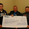 The Proceeds from an Open Singles Darts Tournament in the Newry Orange Hall in aid of Newry Hospice, Johnathon Wharton (left) and Edgar Mc Cleaghan (organisers) hand over a Cheque for £750.00 to Rev Norman Hutton . 06W45N61