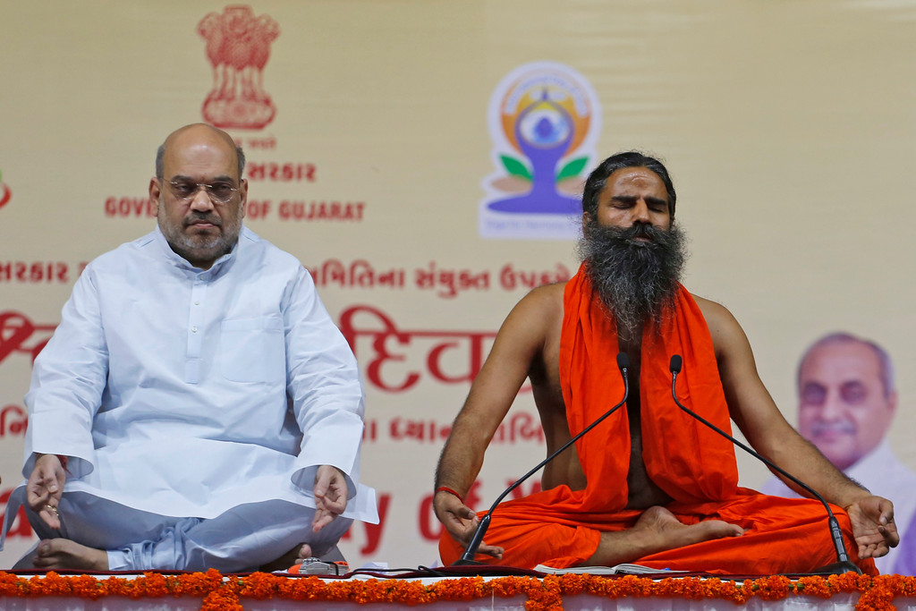 . Yoga guru Baba Ramdev, right and India\'s ruling Bharatiya Janata Party President Amit Shah perform Yoga during International Yoga Day celebrations in Ahmadabad, India, Wednesday, June 21, 2017. Millions of yoga enthusiasts across India take part in a mass yoga sessions to mark the third International Yoga Day which falls on June 21 every year. (AP Photo/Ajit Solanki)