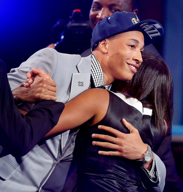 . Dante Exum, left, hugs friends and family after being selected by the Utah Jazz as the fifth overall pick during the 2014 NBA draft, Thursday, June 26, 2014, in New York. (AP Photo/Jason DeCrow)