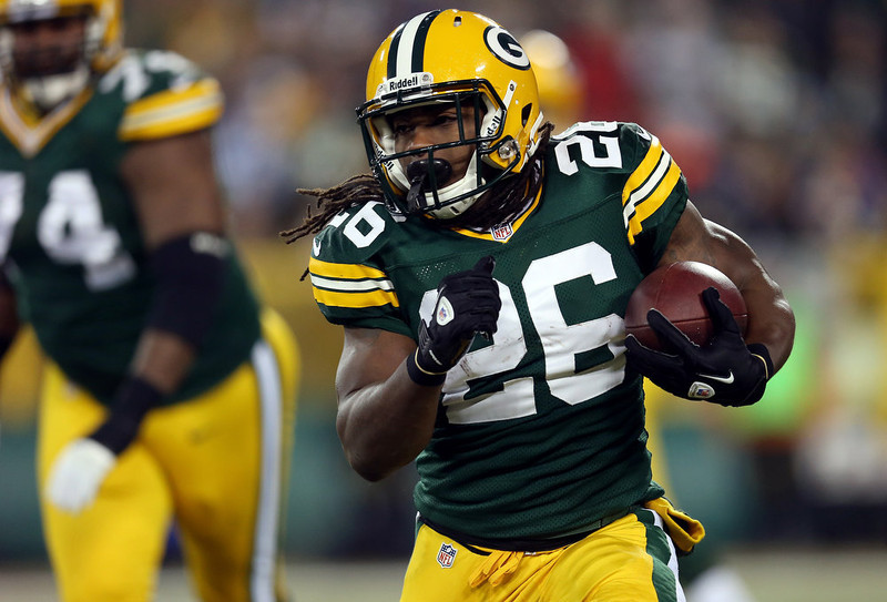. Running back DuJuan Harris #26 of the Green Bay Packers runs the ball in the first quarter against the Minnesota Vikings during the NFC Wild Card Playoff game at Lambeau Field on January 5, 2013 in Green Bay, Wisconsin.  (Photo by Jonathan Daniel/Getty Images)