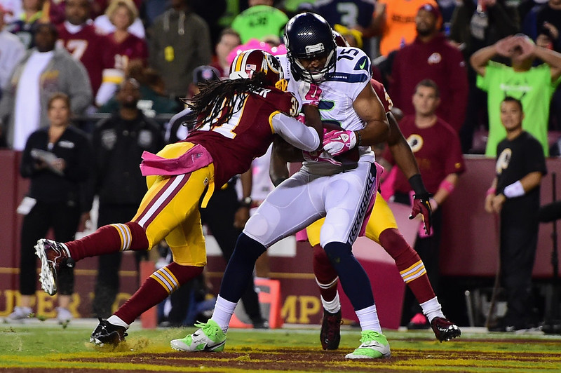. Wide receiver Jermaine Kearse #15 of the Seattle Seahawks catches a first quarter touchdown pass while defended by strong safety Brandon Meriweather #31 of the Washington Redskins at FedExField on October 6, 2014 in Landover, Maryland.  (Photo by Patrick Smith/Getty Images)