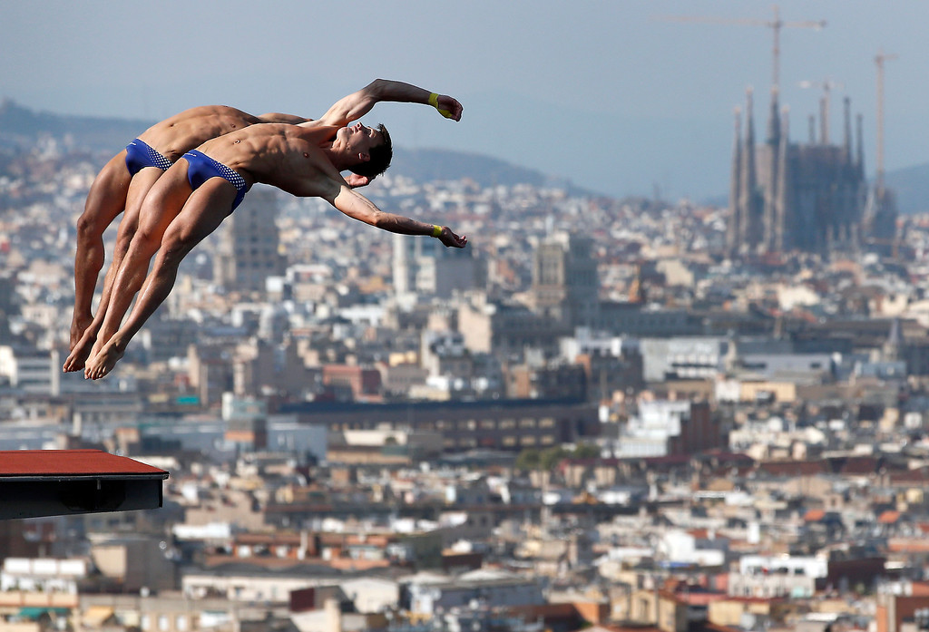 . Gold medalists Patrick Hausding and Sascha Klein from Germany perform during the men\'s 10-meter platform final at the FINA Swimming World Championships in Barcelona, Spain, Sunday, July 21, 2013. (AP Photo/Michael Sohn)
