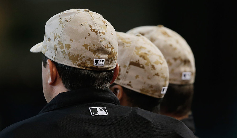 . Umpires wear camouflage pattern caps on the field before the start of the game between the Colorado Rockies and the Houston Astros at Minute Maid Park on May 27, 2013 in Houston, Texas.  (Photo by Scott Halleran/Getty Images)