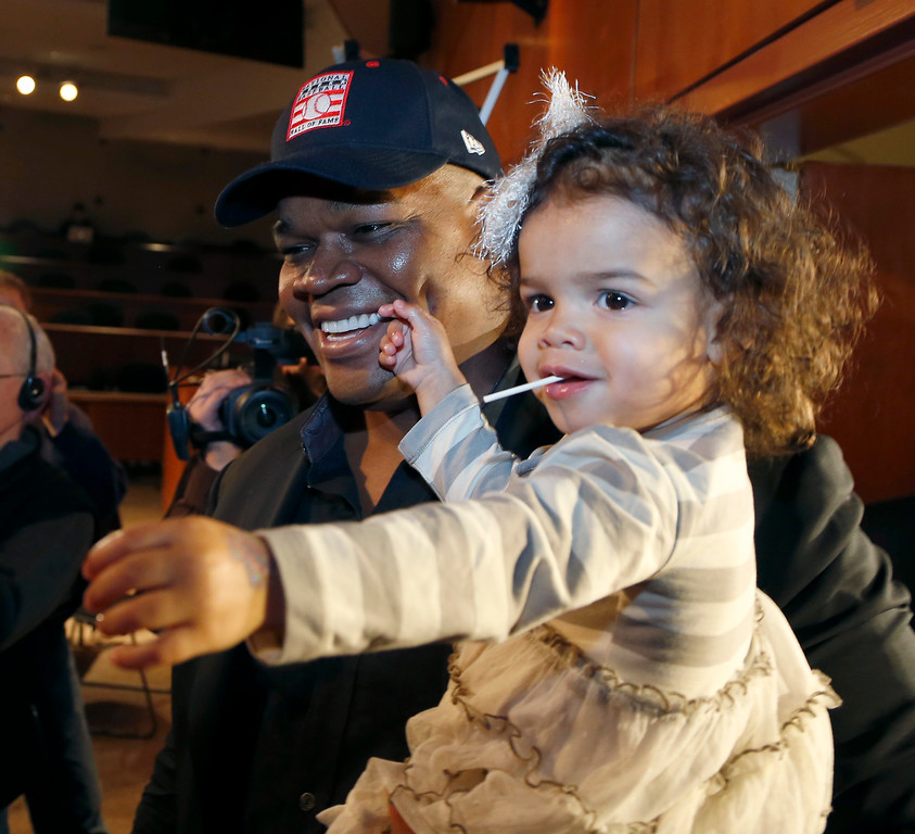 . Chicago White Sox slugger Frank Thomas holds his two-year-old daughter Ashley after a news conference about his selection into the MLB Baseball Hall Of Fame Wednesday, Jan. 8, 2014, at U.S. Cellular Field in Chicago. Thomas joins Greg Maddux and Tom Glavine as first ballot inductees Wednesday, and will be inducted in Cooperstown on July 27 along with managers Bobby Cox, Joe Torre and Tony La Russa, elected last month by the expansion-era committee. (AP Photo/Charles Rex Arbogast)