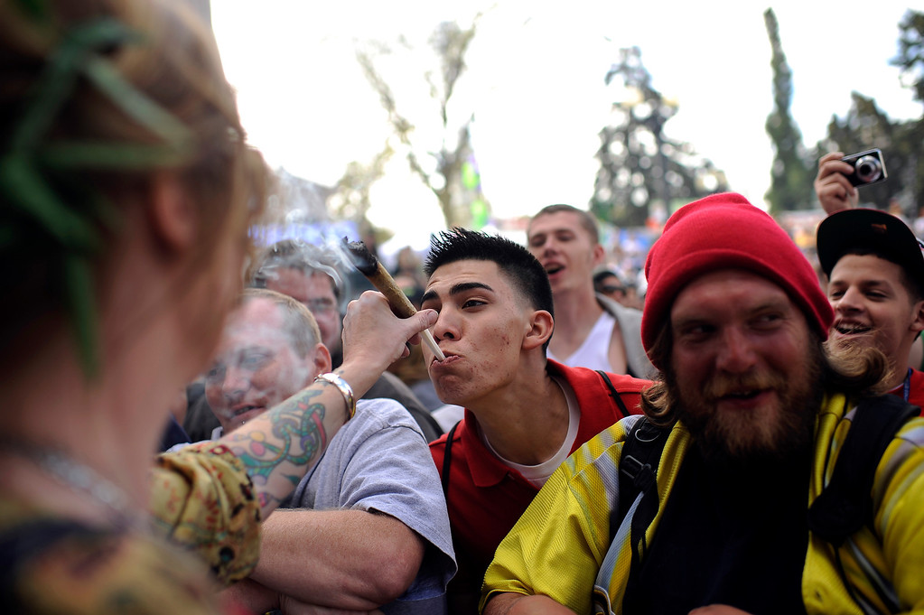 . People celebrating 4/20 Day at Civic Center Park in Denver, Colo., on Friday, April 20, 2012. Hyoung Chang, The Denver Post
