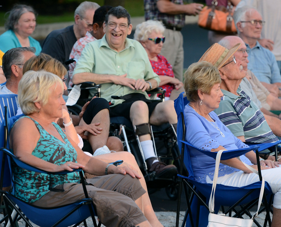 . Audience members listen as musician Bobby Jo Valentine performs an outdoor concert on the front steps of Trinity Lutheran Church in Lansdale  on Wednesday evening August 27,2014. Photo by Mark C Psoras/The Reporter