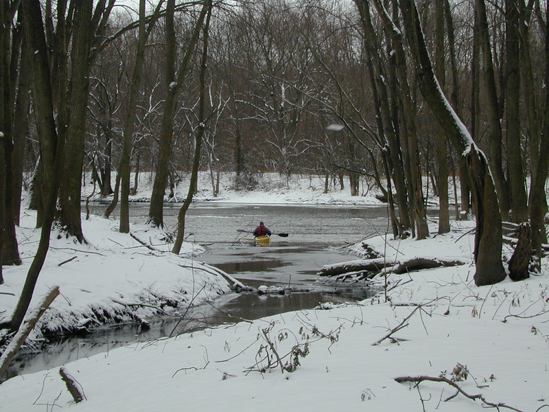 Christmas Day 2002. Confluence of Egypt Creek and the Grand River, just north of the Knapp St. bridge. Dave Aupperlee paddles Perception Carolina purchased at B&P's.