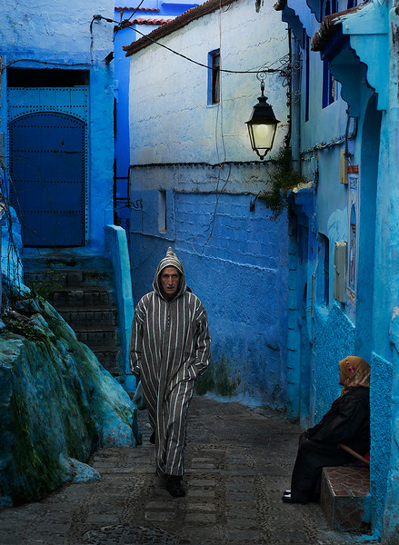 The old medina in Chefchaouen is a delight of Moroccan and Andalucian influence with red-tiled roofs, bright-blue buildings and narrow lanes converging on busy Plaza Uta el-Hammam and its restored kasbah.   Chefchaouen, Morocco, 2018.