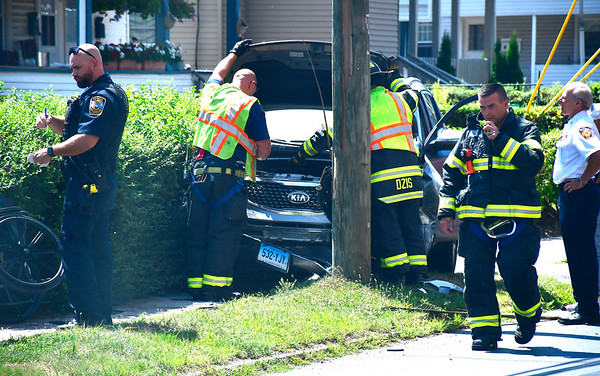 8/15/2019 Mike Orazzi | Staff The scene of a one-vehicle crash involving KIA SUV, a utility pole and a man in a wheelchair knocking out power to some on Foley Street Thursday afternoon. The pedestrian in the wheelchair was transported from the scene with non-threatening injuries.