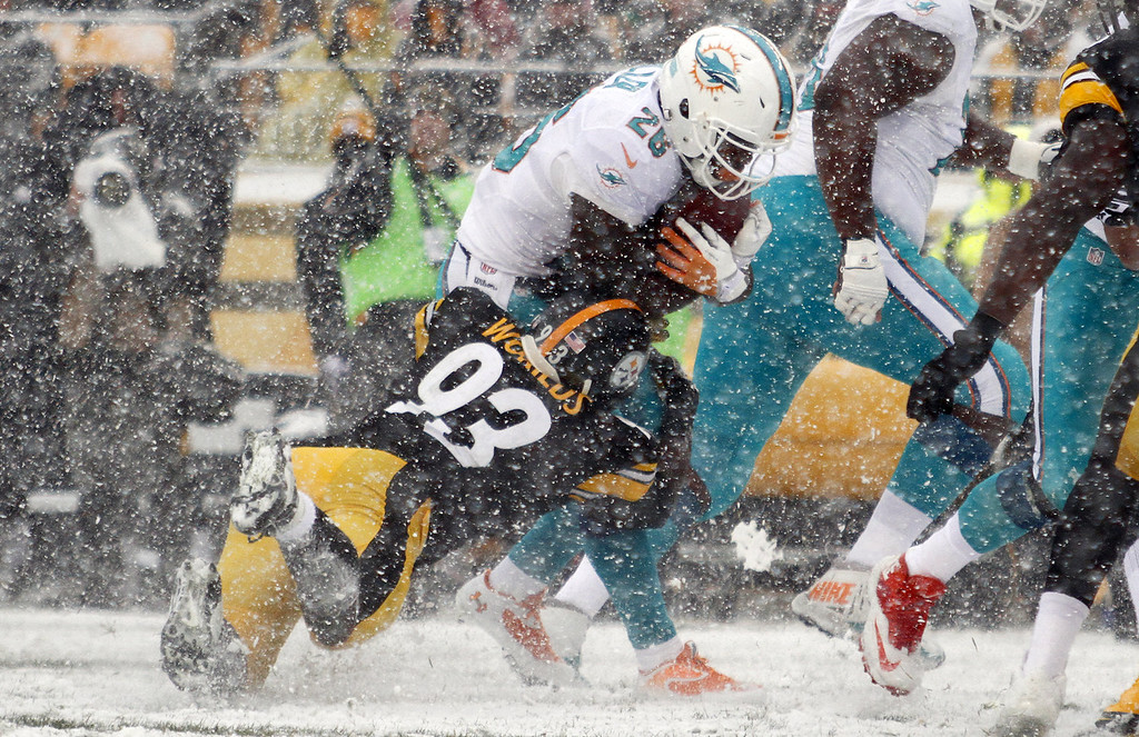 . Jason Worilds #93 of the Pittsburgh Steelers tackles Lamar Miller #26 of the Miami Dolphins during the game on December 8, 2013 at Heinz Field in Pittsburgh, Pennsylvania. (Photo by Justin K. Aller/Getty Images)
