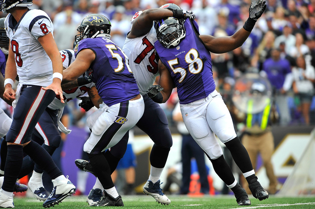 . Outside linebacker Elvis Dumervil #58 of the Baltimore Ravens is held as he rushes the Houston Texans quarterback, penalty not called, at M&T Bank Stadium on September 22, 2013 in Baltimore, Maryland. The Ravens defeated the Texans 30-9. (Photo by Larry French/Getty Images)