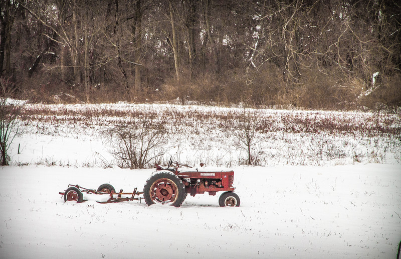 Old Red Farm Tractor in a Snowy Field