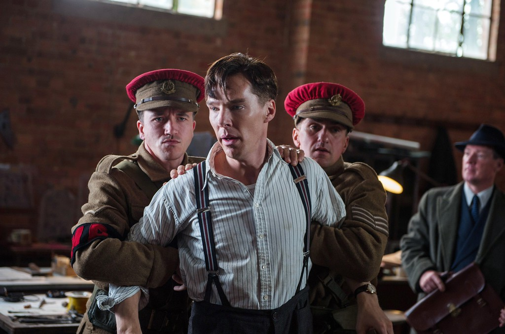 """. In this image released by The Weinstein Company, Benedict Cumberbatch, center, appears in a scene from \""""The Imitation Game.\""""  The film was nominated for a Golden Globe for best drama on Thursday, Dec. 11, 2014. The 72nd annual Golden Globe awards will air on NBC on Sunday, Jan. 11. (AP Photo/The Weinstein Company, Jack English)"""