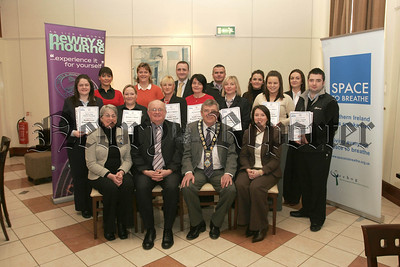 Newry & Mournr Gets Ready To Go Smoke Free, pictured Mayor Micheal Carr who presented the Smoke Free Premises Awards to local Business representatives in the Arts Centre on Wednesday last also in picture front row, Sharon Walker,(Smoke Free Officer), Stephen Cooper, (Area Director Enviromental Health), Sheena Mc Eldowney, (Enviromental Health Officer). 07W8N7