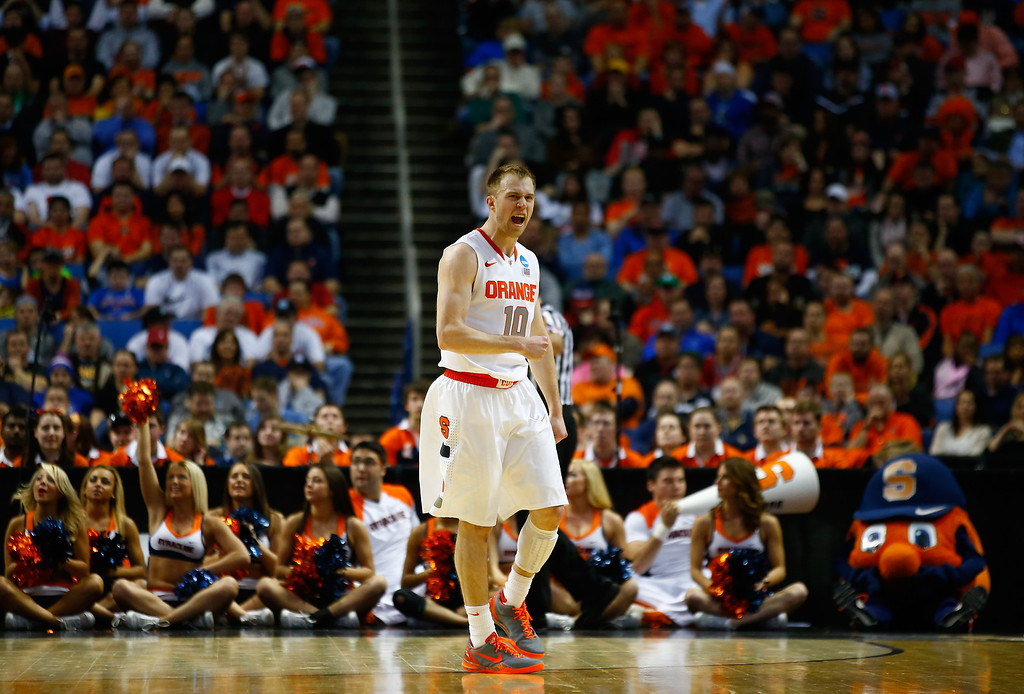. BUFFALO, NY - MARCH 20: Trevor Cooney #10 of the Syracuse Orange celebrates a turnover by the Western Michigan Broncos during the second round of the 2014 NCAA Men\'s Basketball Tournament at the First Niagara Center on March 20, 2014 in Buffalo, New York.  (Photo by Jared Wickerham/Getty Images)