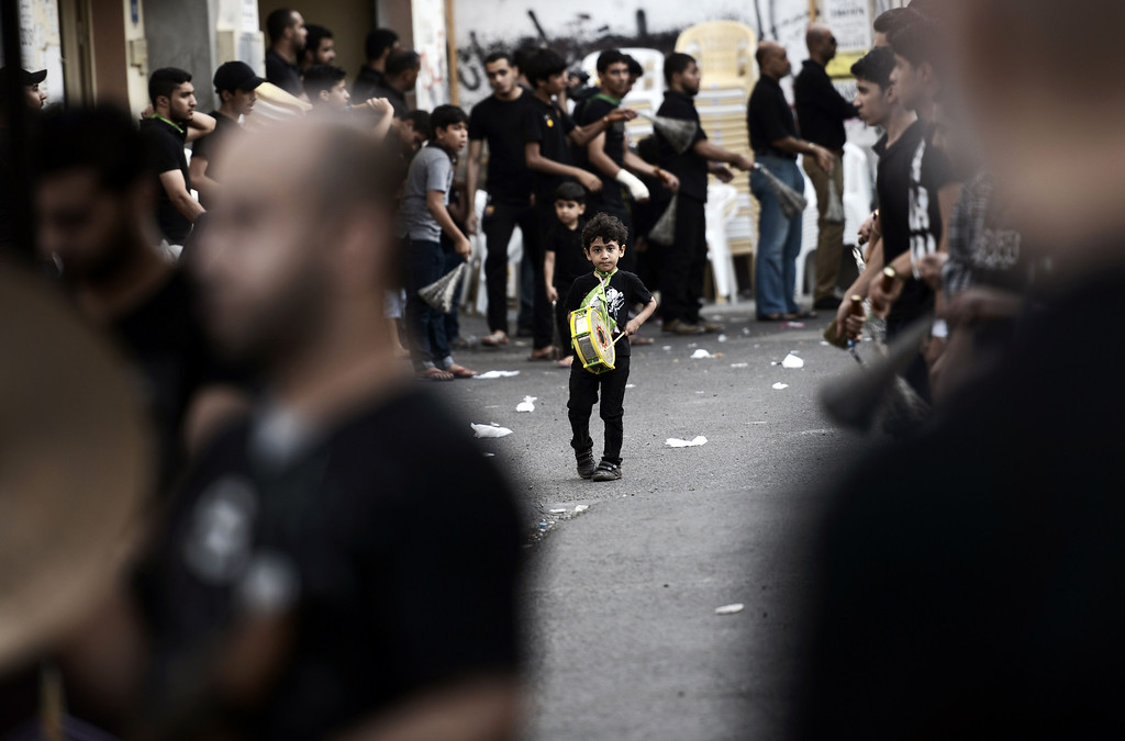 . A Bahraini Shiite Muslim boy takes part in a ceremony marking Ashura, which commemorates the seventh century slaying of Imam Hussein, the grandson of Prophet Mohammed, in the village of Sanabis, west of Manama on November 1, 2014.MOHAMMED AL-SHAIKH/AFP/Getty Images