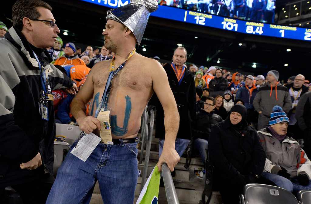 . A rowdy Seahawks fan has his tickets checked by officials during the fourth quarter.  The Denver Broncos vs the Seattle Seahawks in Super Bowl XLVIII at MetLife Stadium in East Rutherford, New Jersey Sunday, February 2, 2014. (Photo by Craig F. Walker/The Denver Post)