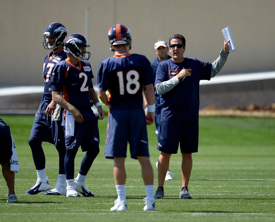 . Denver Broncos quarterbacks coach Greg Knapp gives instructions as Denver Broncos quarterback Peyton Manning (18) and Denver Broncos quarterback Zac Dysert (2) listen in during practice August 25, 2014 at Dove Valley.(Photo by John Leyba/The Denver Post)