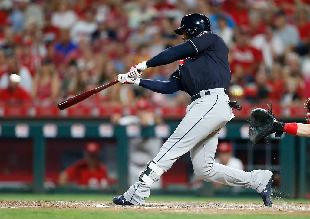 . Cleveland Indians\' Yandy Diaz hits an RBI double off Cincinnati Reds starting pitcher Homer Bailey during the sixth inning of a baseball game, Monday, Aug. 13, 2018, in Cincinnati. (AP Photo/Gary Landers)