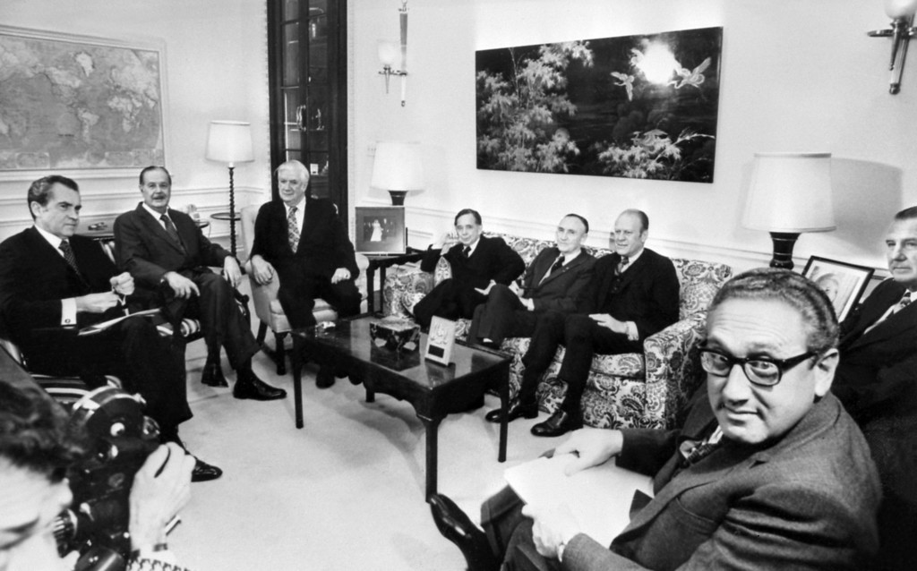 . WASHINGTON - JANUARY 24, 1973:  US president Richard Nixon (L) receives participants of Congress leaders and foreign Secretary of State Henry Kissinger (R), after the signing of ceasefire agreement in Vietnam, 24 January 1973 in Washington. (Photo by AFP/Getty Images)