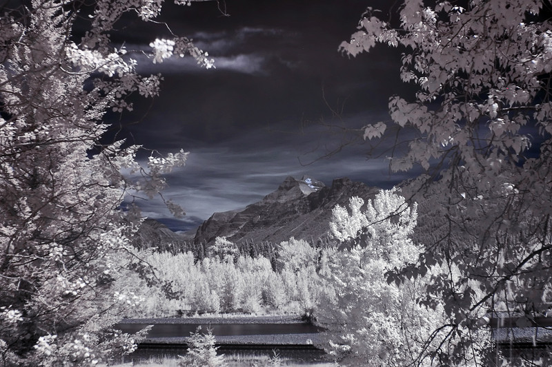 Infrared panorama of the flathead river with the mountains of Glacier in the distance.  This was taken along Highway 2, which runs south of the park and connects East and West Glacier.