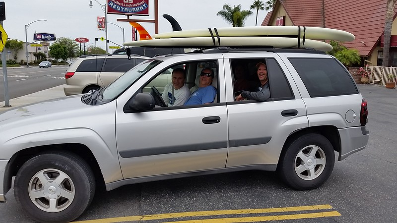 Steve Palmer, who donated an entire case of fine Santa Barbara wines for our NHHS student vocational scholarship fundraiser, was unable to attend the reunion because his brothers kidnapped him on Friday and whisked him away to Catalina Island for the weekend! Steve and his older and younger brothers are pictured here on their way to their boat.
