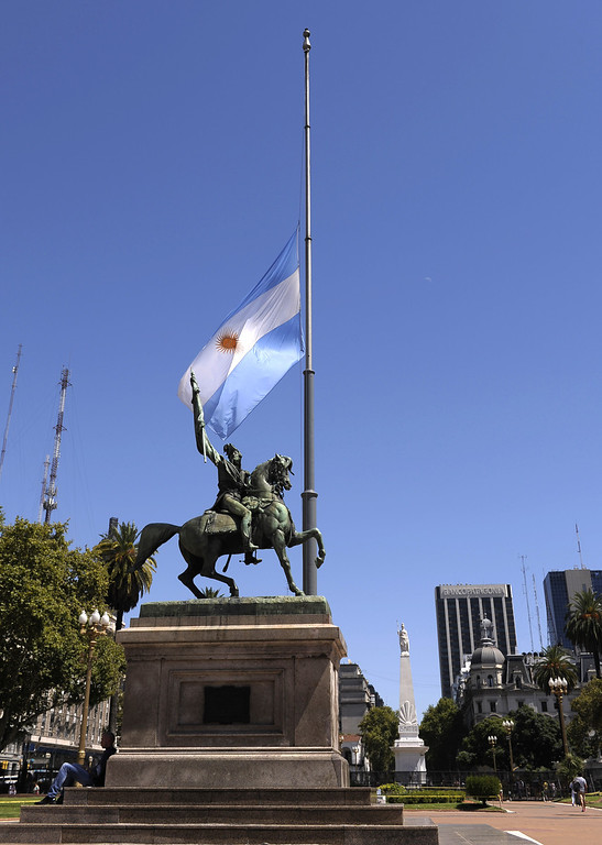 . An Argentine flag at half mast for the demise of Venezuelan President Hugo Chavez, waves at Plaza de Mayo Square in Buenos Aires, on March 6, 2013.  AFP PHOTO/ Alejandro PAGNI/AFP/Getty Images