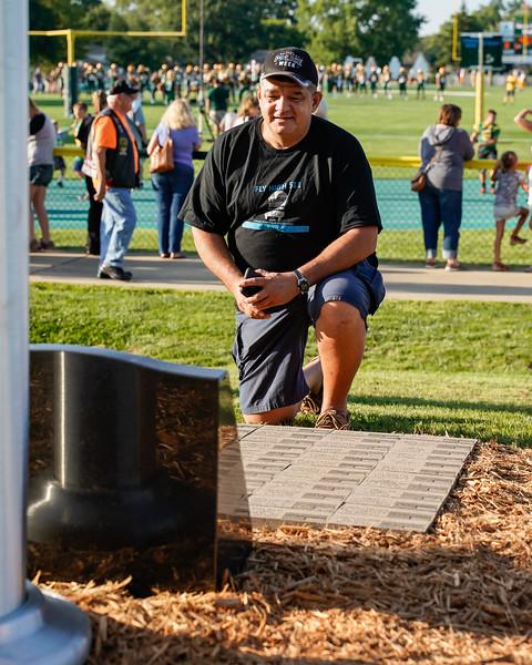 Retired State Highway Patrolman AJ Torres and best friend of fallen officer Kenny Velez takes a moment memorial site.jpg
