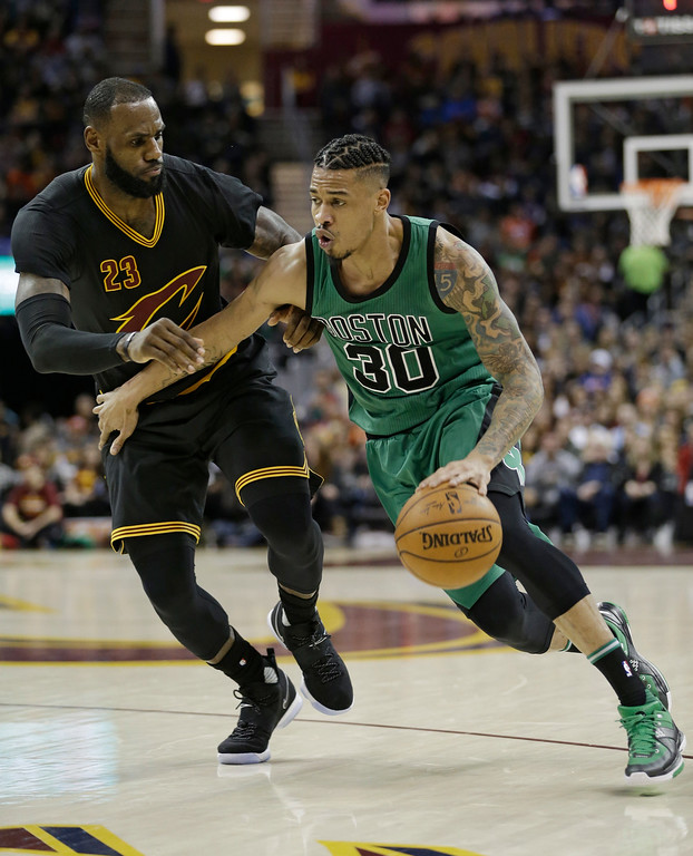 . Boston Celtics\' Gerald Green (30) drives past Cleveland Cavaliers\' LeBron James (23) in the first half of an NBA basketball game, Thursday, Dec. 29, 2016, in Cleveland. (AP Photo/Tony Dejak)