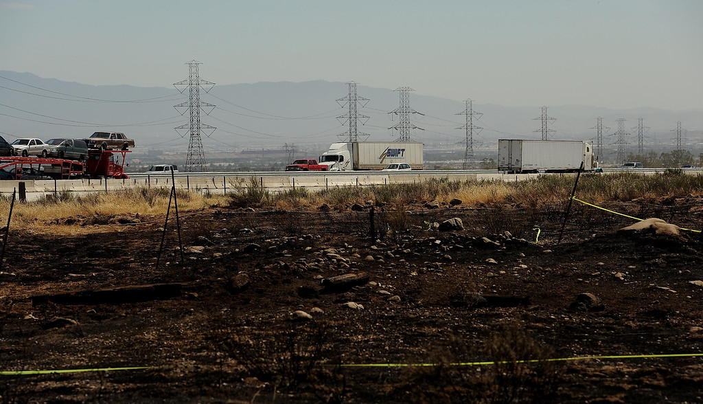 . A view of land burned in Mondays fire along the I-15 freeway near Sierra Avenue exit in North Fontana May 14, 2013.  GABRIEL LUIS ACOSTA/STAFF PHOTOGRAPHER.