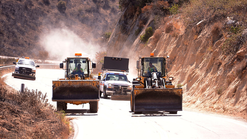 . CalTrans bulldozers clear debris left behind from the Silver Fire as seen along Highway 243 in the mountains south of Banning August 10, 2013.   GABRIEL LUIS ACOSTA/STAFF PHOTOTGRAPHER.
